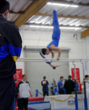 At the gym. Coach watching his gymnast compete Stock Images