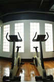 Gym. Indoor gym with exercise bicycle Royalty Free Stock Image