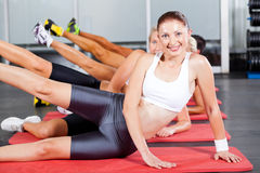 Gym aerobics. Group of people doing gym aerobics stock photography