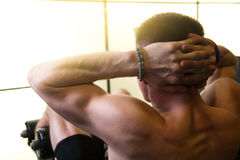 Gym back young man, hands in the castle. Stock Images