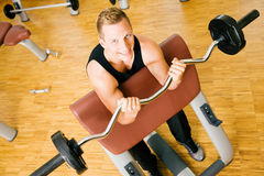 In the gym with barbell Royalty Free Stock Images