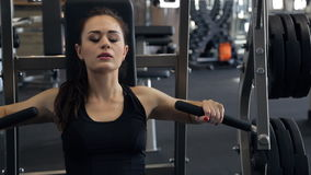 In the gym beautiful woman performs a bench press from the chest. stock video