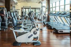 Gym. Bikes room interior cardio row indoors Royalty Free Stock Image