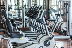 Gym. Bikes room interior cardio row indoors Stock Photography