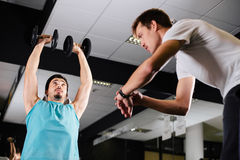 Gym buddies working out timing exercise Royalty Free Stock Images