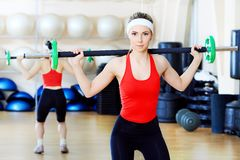 In the gym centre. Young sporty woman in the gym centre Royalty Free Stock Photo