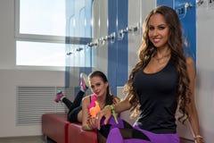 At gym. Charming girls posing in locker room Stock Images