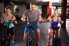 Gym Class Working Out On Cross Trainers Together Stock Images