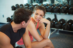 Gym: Couple Takes a Break from Working Out. Series with men and women at the gym, lifting weights, using the treadmill, etc royalty free stock images