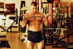 Gym do treinamento do halterofilista Imagem de Stock Royalty Free