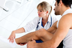 Gym doctor with a patient Stock Photos