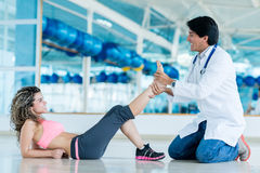Gym doctor with a patient Stock Photography