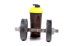 Gym dumbbell and shaker Royalty Free Stock Image