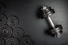 Gym dumbbells with black metal weights 1kg and 2kg on black background with copy sapce, Photograph taken from above royalty free stock photography