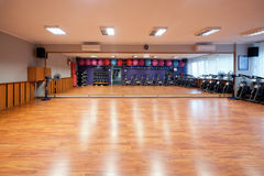 Gym Equipment. Empty gym with equipment including ball micycles and weights Stock Image