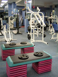 Gym equipment. Weight machines, and steppers at the gym stock images
