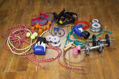 Gym equipment on the wood floor Stock Photography