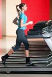 Gym exercising. Run on on a machine. Royalty Free Stock Photos