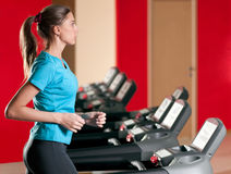 Gym exercising. Run on on a machine. Royalty Free Stock Image