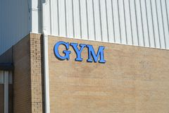 Gym Facility. A Gym is a multipurpose sports and exercise facility where free weights, dumbbells, exercise machines are available for use as well as basketball Stock Photo