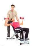 Gym & Fitness. Smiling young woman working out. Isolated over white background royalty free stock images