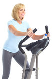 Gym & Fitness. Smiling elderly woman working out. Isolated over white background stock photo