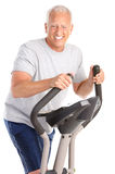 Gym & Fitness. Smiling elderly man  working out. Isolated over white background Stock Images