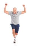 Gym & Fitness. Smiling elderly man working out. Isolated over white background stock photos