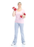 Gym & Fitness. Smiling elderly woman working out. Isolated over white background stock images