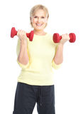Gym & Fitness. Smiling elderly woman working out. Isolated over white background stock photos
