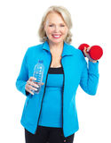 Gym & Fitness. Smiling elderly woman working out. Isolated over white background royalty free stock photo