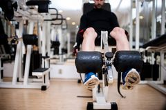 Gym fitness center with young man working out Royalty Free Stock Photography