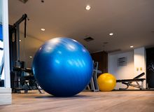 Gym for fitness exercises with aerobic Fitball on the floor. Gym for fitness exercises with aerobic Fitball on the floor: Concept for Healthy lifestyle Royalty Free Stock Image