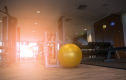 Gym for fitness exercises with aerobic Fitball on the floor. Gym for fitness exercises with aerobic Fitball on the floor in the morning Royalty Free Stock Image