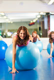 Gym fitness women - Training and workout Stock Photography