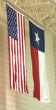 Gym Flags. American and Texas flags hanging from gymnasium ceiling royalty free stock images