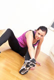 Gym girl stretching exercise Royalty Free Stock Photos