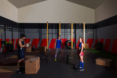 Gym group workout barbells slam balls and jump Royalty Free Stock Photos