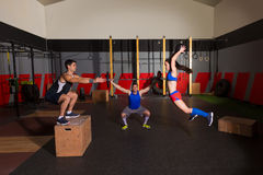Gym group workout barbells slam balls and jump. Gym people group workout barbells slam balls and jump exercises stock images