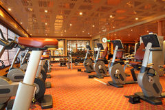 Gym hall with running tracks, exercise bicycle Royalty Free Stock Photo