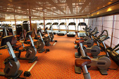 Gym hall with treadmills and exercise bicycle Royalty Free Stock Photo