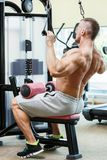 Gym. Handsome man during workout Stock Image