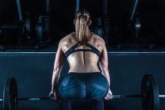 Gym hard training woman. Woman hard   training in gym Royalty Free Stock Photos