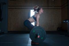 Gym hard training woman. Woman hard   training in gym Stock Image