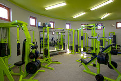 Gym hardware - gym interior. Machines to the strengthening of the body Royalty Free Stock Photography