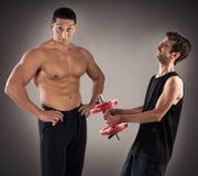 Gym instructor mockingly Stock Photo