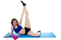 Gym instructor teaching warm up exercises Royalty Free Stock Images