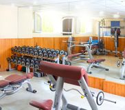 Gym interior bodybuliding weights exercise room Stock Photo