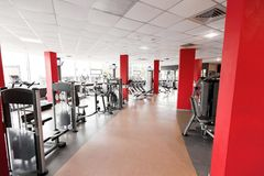 Gym Interior With Diversity Of Fitness Stations Royalty Free Stock Photography