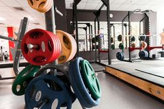 Gym Interior With Weight Plates Close Up Stock Photos